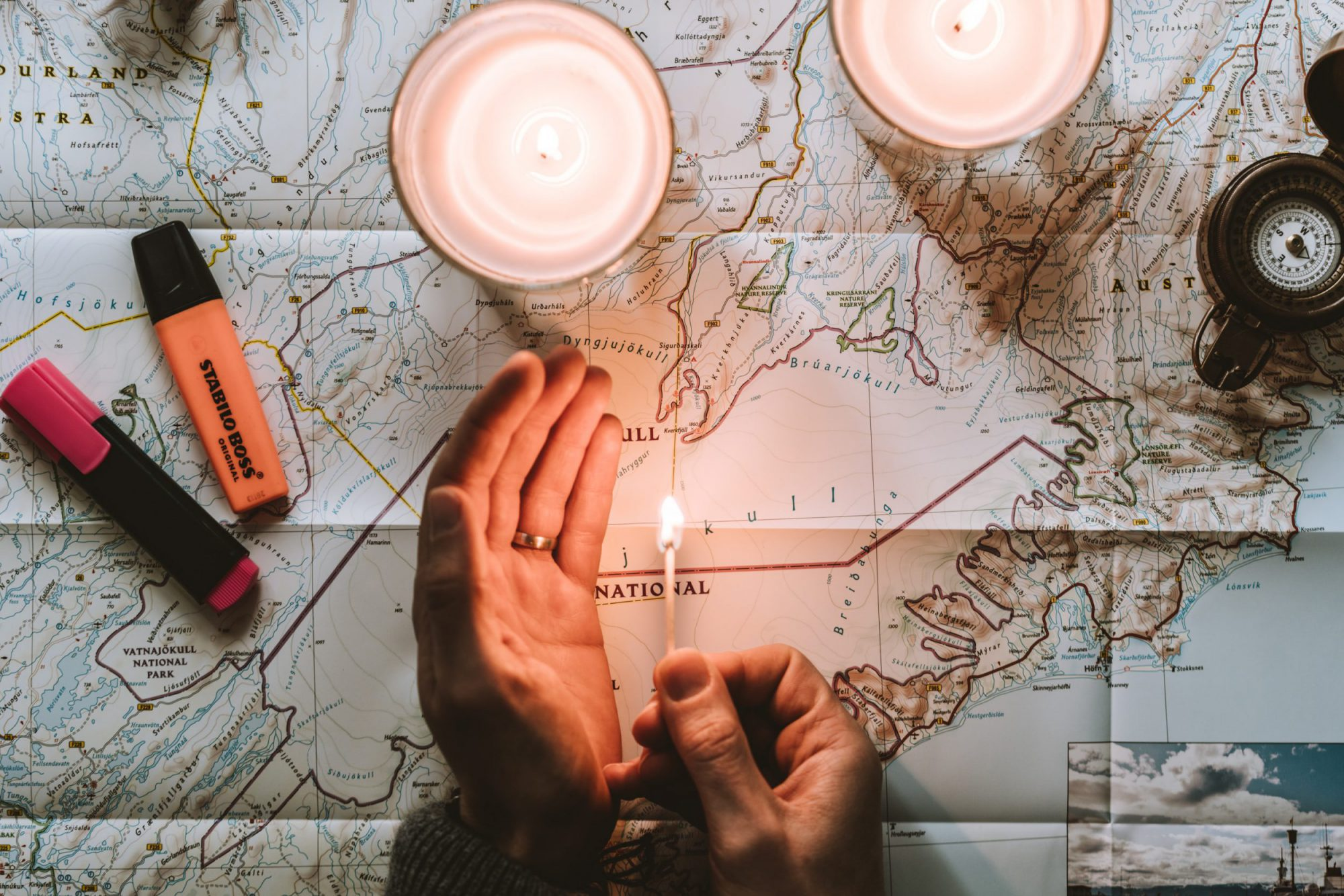 a map with a man holding a candle